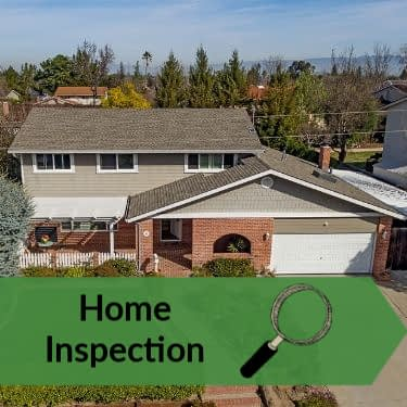 Home inspection graphic - aerial view of house with magnifiying glass and words Home Inspection