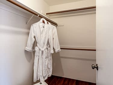 Staging in closet - closet staged with robe and suitcases